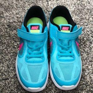 Blue nike revolution running shoes